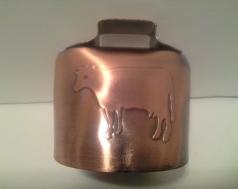 Needs more cow bell......Copper cow bell, with picture of cow