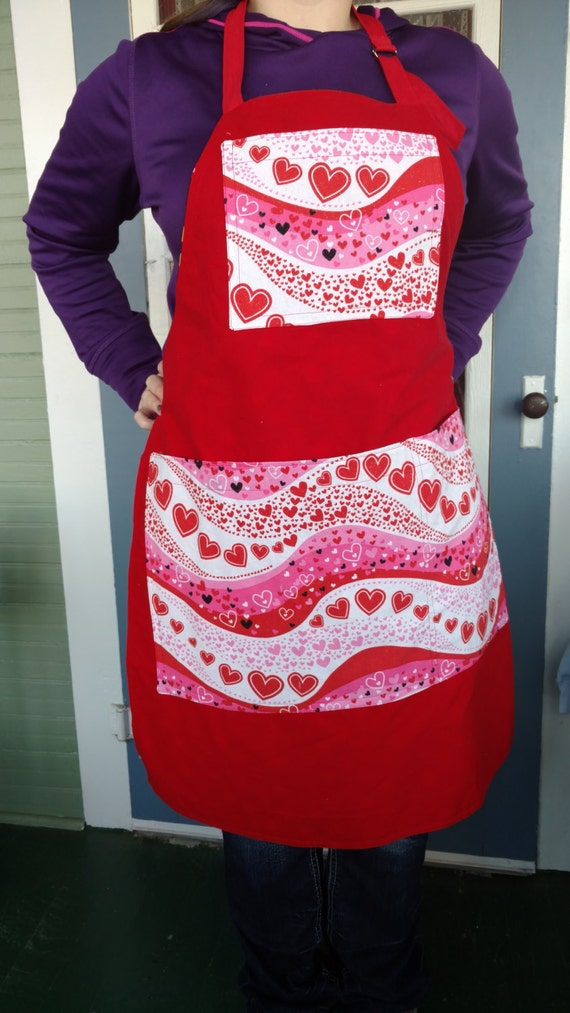 Valentine/floral Print Apron Waves Of Hearts Print With Generous Jumbo Size  Divided Pockets Reverses To Bright Primary Colored Flowers On Black.