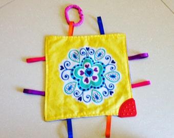 Taggie blanket sensory toy