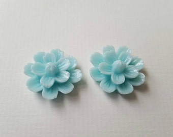 2 large blue cabachon flowers