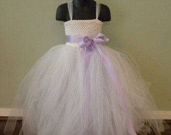 Beautiful white tutu dress with a lavender bow.