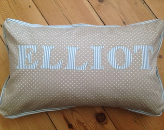 Personalised name cushion.