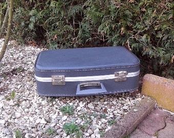Vintage blue plastic suitcase