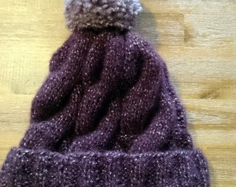 Super hat with cables and hand knitted Pompom