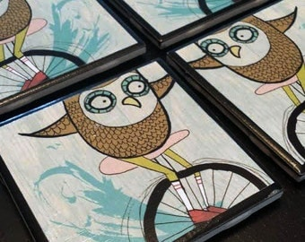 Owl on a unicycle coasters