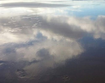 Clouds reflected on sand