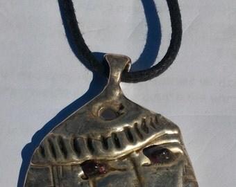Silver face pendant