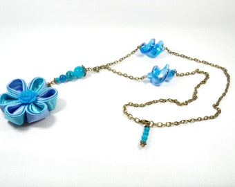 Blue kanzashi Flower necklace and its glass beads.