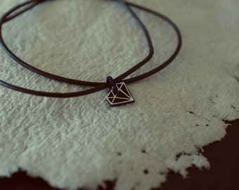 Necklace with leather band and diamond shaped pendant