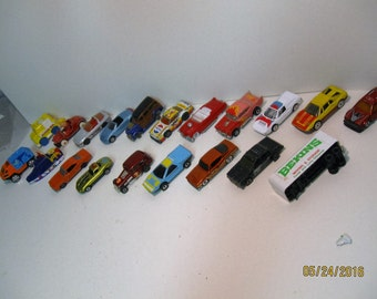 Assortment of metal and plastic toy cars