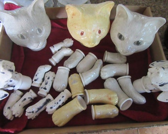 Cats and Dalmatians dogs heads and body's parts to make your own stuff toy's two dogs and three cats parts. Perfect condition.