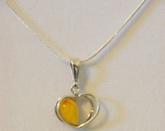 Baltic Amber Heart shaped pendant set in 925 silver, yellow