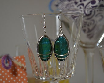 Earrings of glass and Tin. Turquoise oval