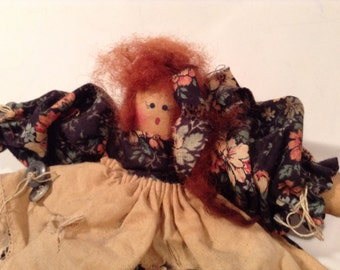 Vintage hand-sewn doll with black dress