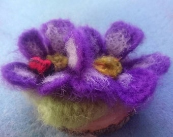 Needle felted flowers with a ladybird