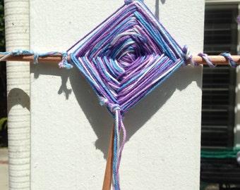 purple,white,dark purple,and light blue Gods eye