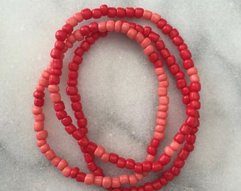 Pink and Red Beaded Bracelets