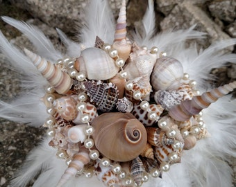Natural color sea shell bouquet with feathers and pearls, beach wedding