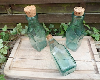 Lot of 3 antique bottles, green glass bottles, thick glass bottles, vials square