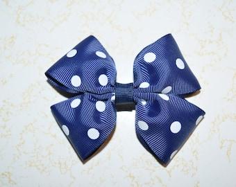 Navy blue and white polka dot girl's hair bow
