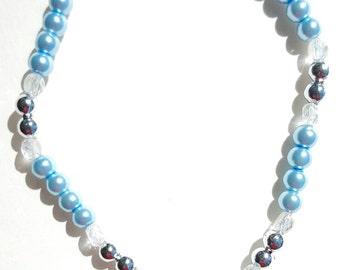 Glass Pearls, Swarovski Tear Drop and Czech Glass with a faux clasp.