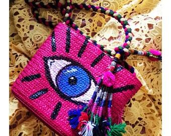Evil eye straw bag