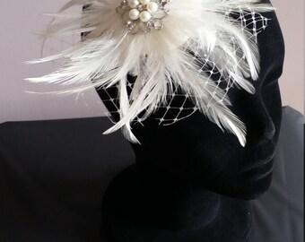 Stunning ivory bridal feather headpiece