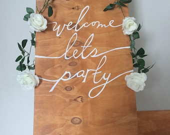Welcome lets party sign