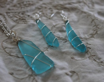 Wire wrapped blue beach glass pendant on 24inch silver chain, with matching earring set.