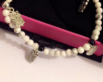 Natural gemstone beaded bracelet with multiple charms