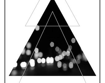 Minimalist black & white digital print with bokeh city lights detail