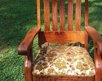 antique   lion's paw rocking chair