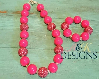 shocking pink chunky bead necklace and bracelet