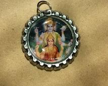 """Lakshmi and Krishna Bottle-cap Pendant 1"""""""
