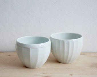 A set of two porcelain cups/bowls
