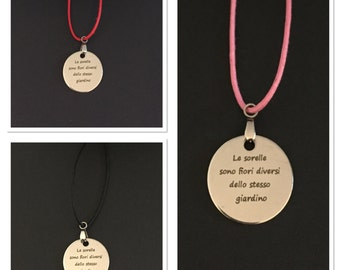 Necklace with pendant with a dedication to the sisters