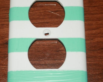 Blue and white striped outlet cover