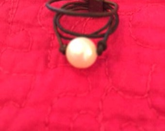 Leather and white pearl ring