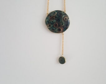 Contemporary Spiraling Pendant. brass &resin