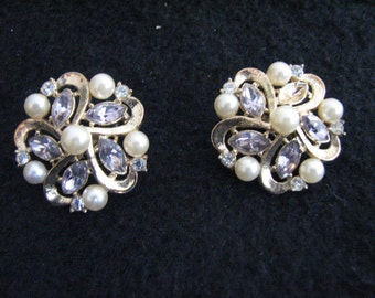Stunning vintage Trifari faux pearl and rhinestone clip on earrings, signed