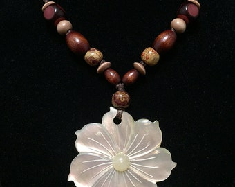 White flower necklace with wood beads.