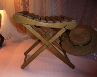 A small former stool fully Folding wooden