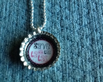 Bottle cap necklaces and keychains