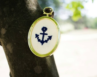 "Navy blue cross-stitched anchor (2"" gold plastic oval)"