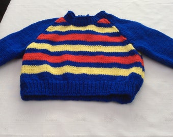 Hand knitted jumper.