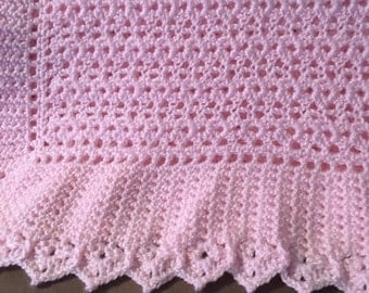 Pink crocheted baby blanket