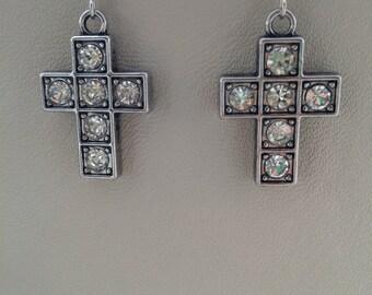 Cross charm earrings with rhinestones in silver tone