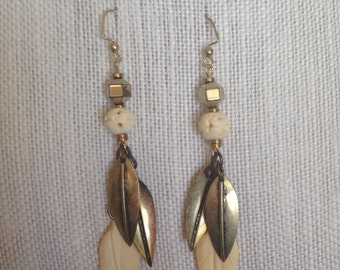 Gold tone metal and carved bone feather earrings