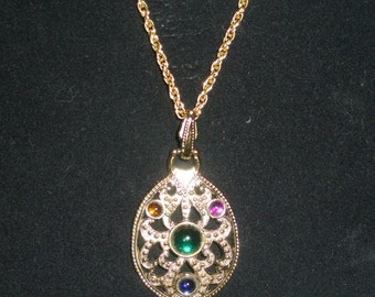 Goldtone medallion neckace with colored stones