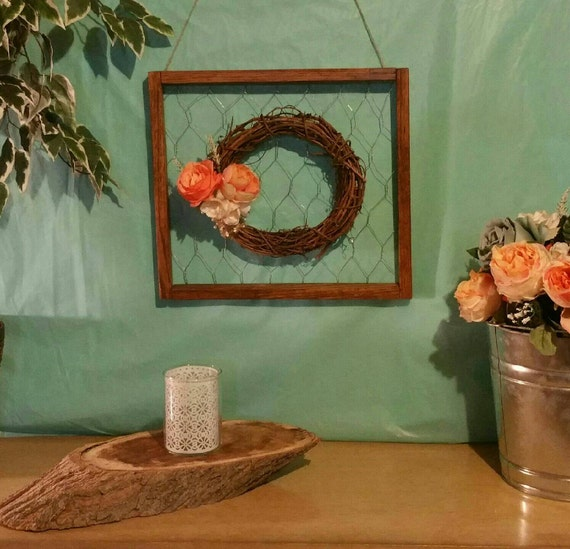 Rustic frame with chicken wire and grapevine wreath